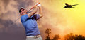 Golfer shooting a golf ball photo of Stock Photography