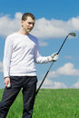 The golfer stands on grass and holds the ball Royalty Free Stock Photo