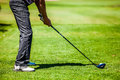 Golfer at the start with copyspace for your text on a golf course on lot of preparation Stock Photo