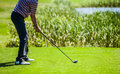 Golfer at the start with copyspace for your text on a golf course on lot of preparation Royalty Free Stock Photo