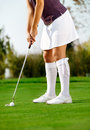 Golfer swing golf ball on the grass female Royalty Free Stock Photo