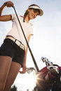 Golfer taking out iron from golf bag. Royalty Free Stock Photo