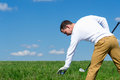 the golfer throws a ball Royalty Free Stock Photo
