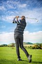 Golfer women pretty young lady view from below against a blue sky Royalty Free Stock Image