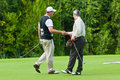 Golfers shake hands Stock Photography