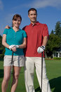 Golfers Smile at Camera - Vertictal Stock Photography