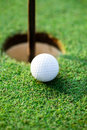 Golfing golf ball next hole close up Royalty Free Stock Photo