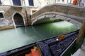 Gondola berthed of venezia along a canal Stock Images