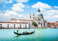 Gondola on canal grande with basilica di santa maria della salute venice italy in the background Royalty Free Stock Photos