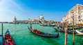 Gondola on canal grande with basilica di santa maria venice italy beautiful view of traditional historic della salute in the Royalty Free Stock Image