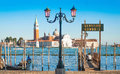 Gondola on canal grande with san giorgio maggiore church in venice italy the background as seen from marco Stock Photo