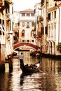 Gondola on canal in venice traveling down the canals of italy Stock Photos