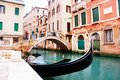 Gondola docks near calle zancani street and and small canal in venice italy Stock Photo