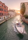 Gondola with gondolier in venice italy channel Royalty Free Stock Photo