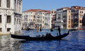 Gondola on the grand canal a gondolier guides his in venice italy photo taken o a february Stock Photo