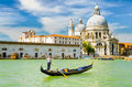 Gondola on the grand canal in venice italy before basilica santa maria della salute Royalty Free Stock Images