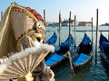 Gondola mask and boats waiting for turists in the venice Royalty Free Stock Photography