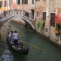 Gondola on narrow canal Royalty Free Stock Photos
