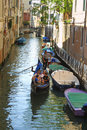 Gondola with passengers in Venice Stock Photo