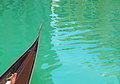 Gondola prow on the water Royalty Free Stock Photo