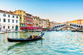 Gondola at the rialto bridge in venice italy with evening light Stock Images
