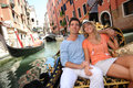 Gondola ride in venice couple having a on the canal Stock Photography