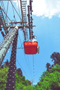 Gondola ropeway above city with mountains in the back Royalty Free Stock Photo