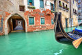 Gondola on small canal in Venice, Italy. Royalty Free Stock Photos