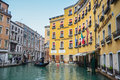 Gondola with tourists sailing in water canal venice italy february sightseeing and a through a next to hotel cavalletto on Stock Photo