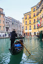 Gondola with tourists in water canal venice italy february sailing a through a next to hotel cavalletto on february th venice Stock Photos