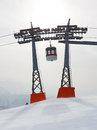 Gondola between two Ski Lift Pylons Royalty Free Stock Photo