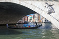 Gondola under rialto bridge in venice italy may a with japanese tourists is passing other gondolas and ferries are farer visible Royalty Free Stock Photos