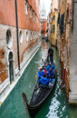 Gondola venice italy april image with tourists and on small channel of taken on th april is a traditional venetian Stock Photos