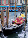 Gondola in venice italy single waiting for tourists to come for a traditioal boat ride on the canal Royalty Free Stock Images