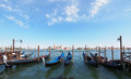Gondolas anchored on Grand Canal in Venice Stock Photos
