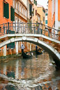 Gondolas on canal in Venice Stock Photography