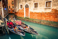 Gondolas on canal in venice narrow italy Royalty Free Stock Photo