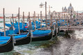 Gondolas docked along grand canal in venice Royalty Free Stock Photo