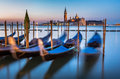 Gondolas, Grand Canal and San Giorgio Maggiore Church at Dawn Royalty Free Stock Photo