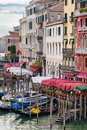 Gondolas on the Grand Canal in Venice next to old colorful palaces Royalty Free Stock Photo