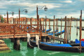 Gondolas moored in row on grand canal in venice a at wooden pier italy Royalty Free Stock Photos