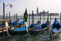 Gondolas moored by Saint Mark's square in Venice Royalty Free Stock Image