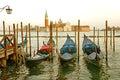 Gondolas moored by Saint Mark square with San Giorgio di Maggiore church in the background - Venice, Venezia, Italy, Europe Royalty Free Stock Photo