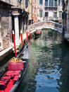 Gondolas moored in side canal venice between historic old buildings low water italy Royalty Free Stock Photos