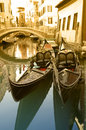 Gondolas mooring along canal typical view at venice italy Stock Photo