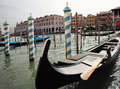 Gondolas at moorings venice italy september traditional flat bottomed venetian rowing boats in sea lagoon on townscape background Royalty Free Stock Photos