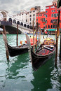 Gondolas near rialto bridge in venice italy Royalty Free Stock Image