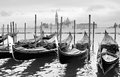 Gondolas near saint mark square in venice italy black and white image Stock Images