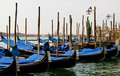 Gondolas, next to the shore of Venice, Italy Stock Image