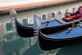 Gondolas a pair of the front in a canal in venice italy Stock Image